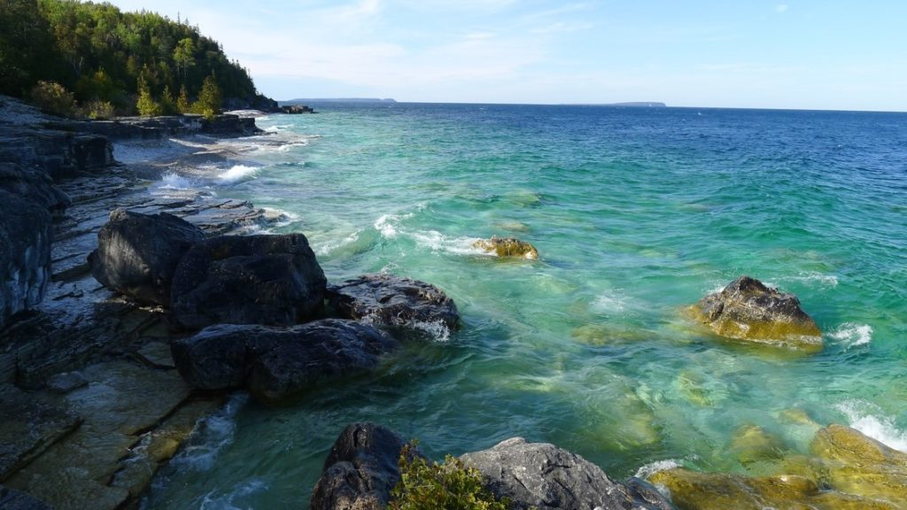turquoise and blue water on a rocky Canadian coastline
